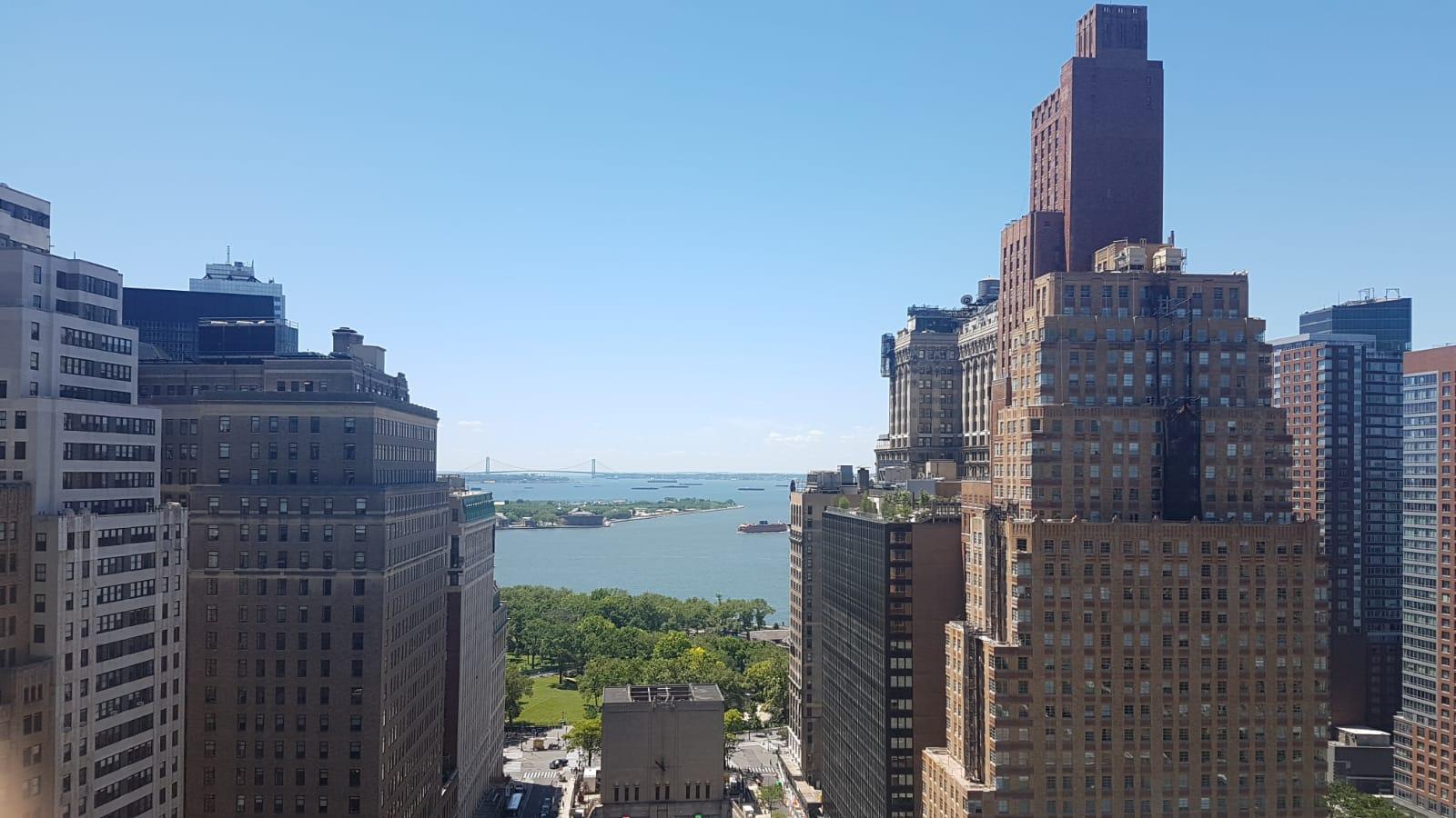 Manhattan rooftop. Men in Black headquarters.